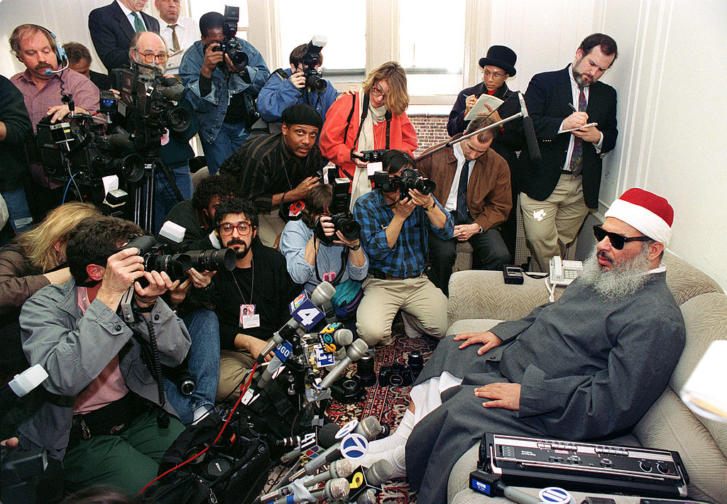 Sheikh Omar Abdel Rahman, the blind spiritual leader of Egypt's largest Islamic extremist fundamentalist group Jamaa Islamiyya faces photographers and reporters, in April 1993, months after a deadly bombing at the World Trade Center in which he was implicated.